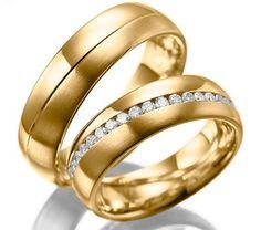 Alianzas de matrimonio en oro de 18K, con brillantes.