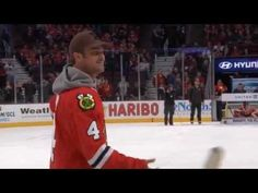 Taylor Kinney, star of Chicago Fire, plays Shoot the Puck at the United Center.