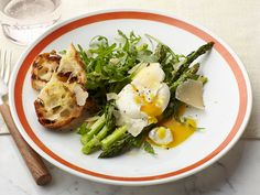 Grilled Asparagus with Poached Egg, Parmigiano and Lemon Zest recipe from Anne Burrell via Food Network