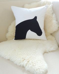 This horse head appliqué pillow cover adds a chic equestrian layer to your interior space in a modern black and white color combo. AS SEEN IN