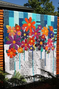 Indah Blossoms is a beautiful, bright floral lap size quilt. The very simple but effective pieced top is made from a selection of contrasting fat quarters. Favourite scraps or fat quarters, eights… Lap Quilts, Quilt Blocks, Mini Quilts, Quilt Modernen, Flower Quilts, Fabric Flowers, Quilt Patterns Free, Free Pattern, Patchwork Patterns