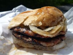 Double Brat Burger from Sheboygan, Wisconsin-As Sheboygan is synonymous with bratwurst, its signature sandwich, the double brat, is synonymous with tailgating parties (and, it appears, coronary occlusion). You start with two brats — usually in encased sausage form, sometimes smashed into patties — which are preferably cooked over charcoal, though places that really do it that way are rare these days. You slap them both on a particular kind of bun called a Semmel roll in Germany (in…