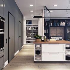 apartamento pequeño, en colores neutros, donde abundan los grises oscuros y el negro, con toques evidentemente masculinos, luces más ténues.