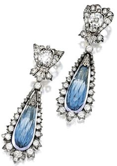Sapphire and diamond earrings. Each suspending on an oscillating briolette sapphire altogether weighing approximately carats, within a stylised frame pavé-set with old-cut diamonds extending to. Sapphire And Diamond Earrings, Blue Earrings, Pendant Earrings, Diamond Pendant, Gems Jewelry, Bridal Jewelry, Jewelery, Jewelry Accessories, Fine Jewelry