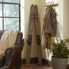 Teak Wood Ski Wall Decor, Vintage Stone | Turn your home into a winter cabin with these teak wood skis. An aged finish adds vintage character to the replica.