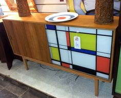 Mid 20th Century Sideboard with glazed Mondrian sliding door ... love the sliding door on this sideboard.