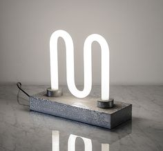 M lamp by Ingo Maurer, on sightunseen.com