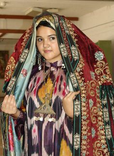 "Central Asia | ""Ferghana museum .. young Uzbek girl in old traditional costume .. silk ikat, jewellery, paranja"" ...From Gülten Urallı Facebook photos ... from the album ""in traditional clothes of Central Asia"""