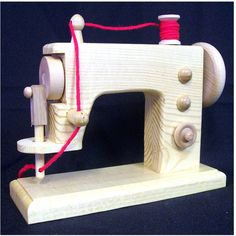 Wood Toy wooden sewing machine....nice