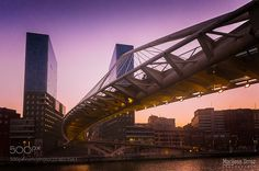 Puente Zubizuri al anochecer by MariaJoseUrroz #architecture #building #architexture #city #buildings #skyscraper #urban #design #minimal #cities #town #street #art #arts #architecturelovers #abstract #photooftheday #amazing #picoftheday