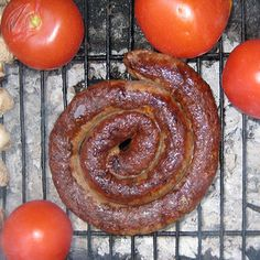 This spiral-shaped sausage is a popular braai (barbecue) meat in South Africa. Made with beef and pork and flavored with coriander and vinegar, boerewors has its roots in the Netherlands. South African Dishes, South African Recipes, Homemade Sausage Recipes, Beef Recipes, Hot Dogs, Farmer Sausage, How To Make Sausage, Sausage Making, International Recipes
