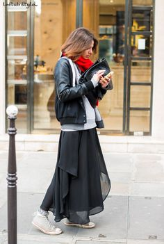Womenswear Street Style by Ángel Robles. Fashion Photography from Paris Fashion Week. Woman wearing maxi skirt with Converse sneakers and black bomber jacket on the street, Paris.