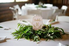 Greenery garland centerpieces for round wedding tables by Country Bouquets Floral