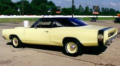 69 superbee in yellow with dog dish hubs.