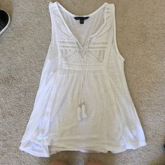 White tank top White tank top with embroidery at the top good condition American Eagle Outfitters Tops Tank Tops