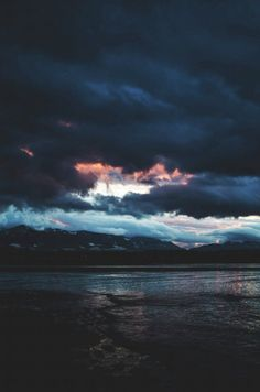 Storm clouds over a lake and mountains - via www.murraymitchell.com