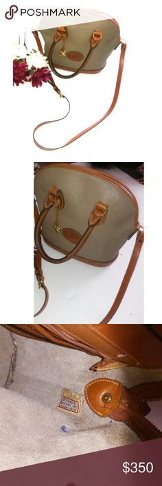 VTG DOONEY & BURKE PURSE Vintage Dooney & Burke Purse Brown and grey tan. Shoulder straps as well as crossbody strap. Has some damage where the color was removed on the purse. Small ink stain in bag.Normal wear and tear considering it is vintage. Overall great condition for age. Dooney & Bourke Bags
