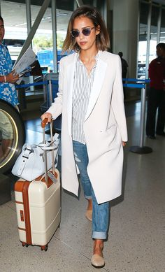 Jessica Alba in a striped shirt, long coat, boyfriend jeans, and flats