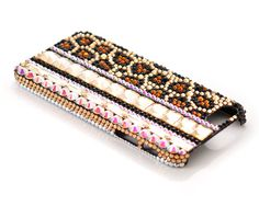 Leopard Grain Bling Crystal Phone Cases - Brown  http://www.dsstyles.com/news/2013/swarovski-elements-leopard-grain-bling-crystal-phone-case-crystal-aurore-boreale-jet-light-colorado-topaz-smoked-topaz.html