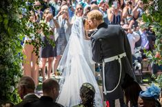 Meghan Markle & Prince Harry seal it with a kiss. <3