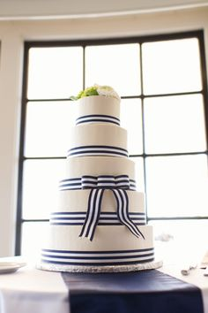 Five tiered navy ribbon cake. Very preppy. Mystic Market. Photography by visual-obsession.com, Floral Design by justforyouweddings.com