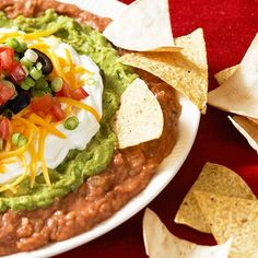 Mexican Seven-Layer Dip Have a fiesta any day with this colorful seven-layer dip. It's packed with all of your favorite Mexican essentials -- beans, guacamole, sour cream, and more. Healthy Dinner Recipes, Mexican Food Recipes, Cooking Recipes, Ethnic Recipes, Appetizer Dips, Appetizer Recipes, Layered Bean Dip, Seven Layer Dip, Sandwiches