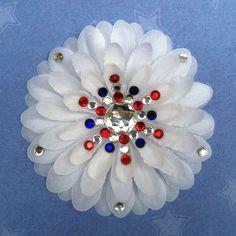 Captain America-inspired Penny Blossom Sparkly White Flower Barrette. $7.50, via Etsy.