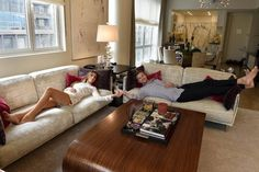 For  News: 09/27/15:Realtors: New York - Ryan Serhant and fiancee Emilia Bechrakis in the living room area of Ryan Serhant's apartment.  Real estate agent to the rich and famous Ryan Serhant owns a penthouse apartment at 22 Renwick St. in West Soho. He's one of the stars of Million Dollar Listing NY and lives like the clients he sells apartments to.  Photo by Helayne Seidman