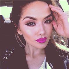 Pink bold lipstick, natrual eyeshadow and wing eyelinear