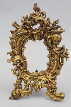 antique French gilt bronze figural frame via: Sarasota Estate Auction
