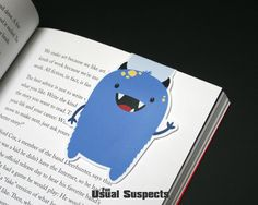 Cute monster paper bookmark. Dave might be a monster, but that doesn't mean he isn't friendly. He has practiced long and hard to turn his snarl into a smile and he's always ready to lend a helping han