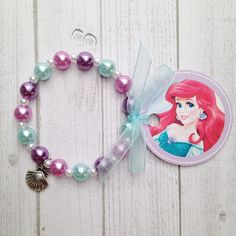8 - Ariel Little Mermaid Charm Bracelet Birthday Party Favor or Slumber Party Favor Ariel Birthday Party Ariel Party Favor by MichelleAndCompany on Etsy Little Mermaid Birthday, Little Mermaid Parties, Mermaid Under The Sea, The Little Mermaid, Slumber Party Favors, Birthday Souvenir, Starfish Bracelet, Kids Jewelry, Homemade Jewelry