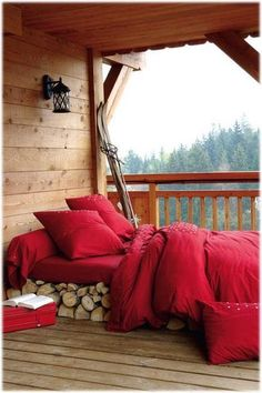 a screened in porch, a comfy mattress on a bed of fire wood, bedding to snuggle up in, a good book, and a view that's out of this world - ohhh yes! - I would definitely sign up for that!