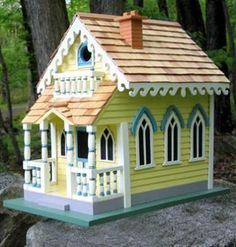 Victorian Cottage Birdhouse spoils your birds enough to return year after year to nest! Bird-friendly features keep babies safe and dry. Unique birdhouse with gingerbread trims and colorful detail on Decorative Bird Houses, Bird Houses Painted, Bird Houses Diy, Fairy Houses, Garden Houses, Bird House Plans, Bird House Kits, Birdhouse Designs, Unique Birdhouses