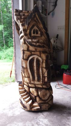 Whimsical house chainsaw carving. Carvell Saw Creations on facebook