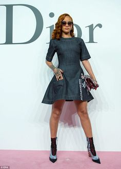 Strike a pose: The 27-year-old singer wowed in a custom made denim mini dress at the runwa...