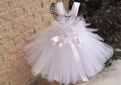 A pure white tutu dress for baby girls, from around 3 to 24 months. Beautifully simple, for any special occasion. The dress has a stretchy, crochet-like bodice, which stretches to 22 inches or so. White Baptism Dress, Girls Baptism Dress, Baby Girl Baptism, Baptism Gown, Christening Gowns, Baby Girls, Girls Pageant Dresses, Gowns For Girls, Baby Girl Dresses