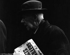 Old school: An undated photo of a man wearing a hat and carrying a newspaper, titled Chicago, Ill. Vivian Maier, Wearing A Hat, Woman Standing, Amazing Pictures, Street Photo, Call Her, Old Photos, Newspaper, Old School