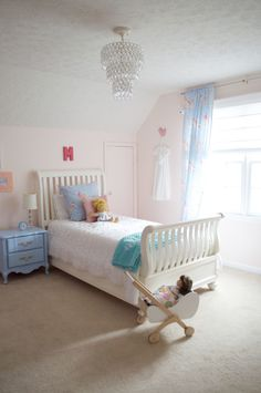Peach + Blue Chic Big Girl Room - love the floral drapes + elegant accents!