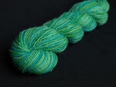 This hand-spun wool yarn has been hand dyed in the colours of the ocean. Hand Dyed Yarn, Hand Spinning, Wool Yarn, Under The Sea, Ocean, Hand Painted, Hands, Colours, Unique Jewelry