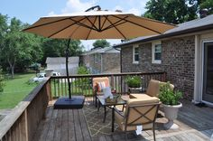 Stunning Balcony Patio Decor with Large Umbrella and Wood Flooring