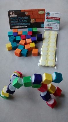 DIY Toddler activity-Velcro Lego! Dollar store craft blocks and velcro dots! $2 total cost. Awesome for plane rides! Pin links to even more busy bag ideas!