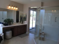 Huge glass #shower and #vanity come standard in this home.