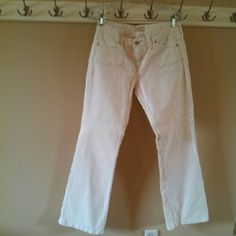 White Levi's Low Boot Cut 545 Jeans Never Worn White Levi's low boot cut 545 jeans. New without tags. Two front pockets & two back pockets. Cotton & Spandex. Machine wash inside out & tumble dry. Size 6 Medium (length). Levi's Jeans Boot Cut