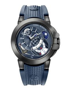 Harry Winston Project Z6 Blue Edition possui um mostrador azul com acabamento acetinado com submostradores circulares com ponto de intersecção para hora local e indicação de alarme. A caixa conta com um revestimento DLC de uma liga chamada Zalium. Para finalizar, uma pulseira de borracha azul