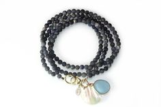 This is a bracellet of dark blue Dumortiert-beads with a large topaz stone and a pearl leaf. The clasp closure is gold plated sterling silver. The bracelet can be wrapped twice.