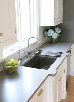 Faucet= Grohe Concetto Dual Spray Pull Down  Counter= Caesarstone in Pebble Wall= Chelsea Gray (HC 168) Benjamin Moore