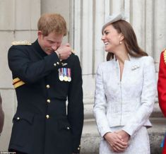 Raising a smile: Prince Harry also shared a joke with the Duchess of Cambridge as they stood on the balcony of Buckingham Palace where the R...