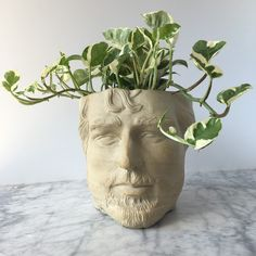 Made a fresh new man planter that's life size! It's unglazed on the outside so the sculpted details are crisp. The inside is glazed white for easy cleaning.