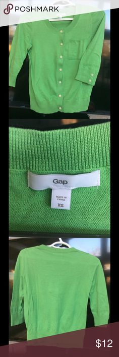 Gap 3/4 Sleeve Cardigan XS 100% cotton Cardigan. Lime green. 3/4 sleeves with button detail. Pocket on the front. Button front. Crop. Great condition. GAP Sweaters Cardigans